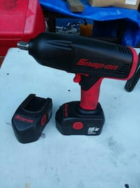 red and black Milwaukee cordless hand drill Jefferson, 21755