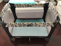 baby's black and white travel cot