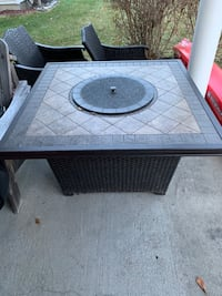 Propane fire pit with 4 wicker chairs