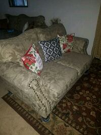 Sofa and loveseat, tan in color and good condition.  North Las Vegas, 89084