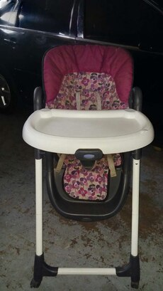 baby's pink, black and white highchair with play