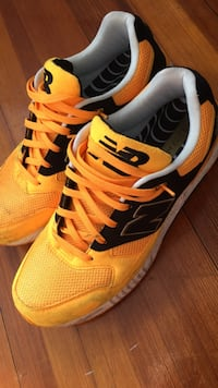Pair of gold-and-black NB elite new balance shoes Boston, 02127