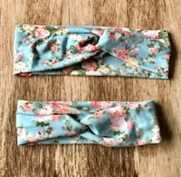 two blue and pink floral textiles London, N5Z