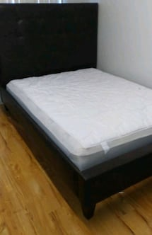 Black queen bed with mattress