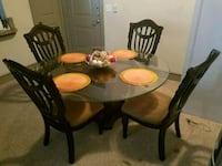 Round glass table with four chairs dining se Houston, 77040