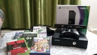black Xbox 360 console with controller and game cases Brampton, L6T