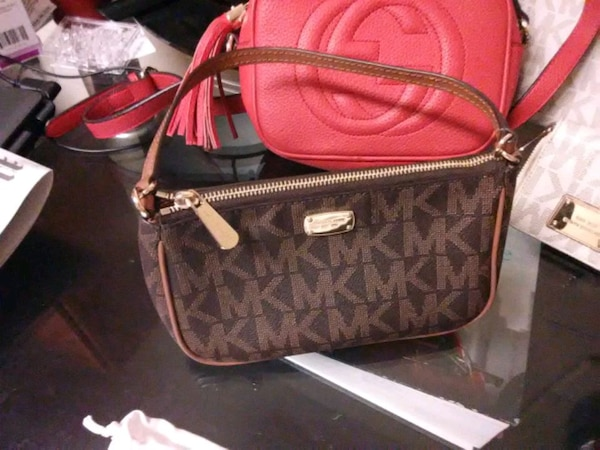 Brwn MK hand purse with strap and Red Gucci purse