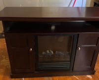 Fireplace in perfect condition, Brown wood finish Montréal, H4V 2M4