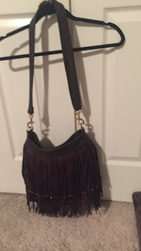 Cute Faux Leather bag with dust bag included.