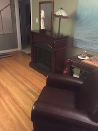 Matching dark brown electric fireplace and brown leather chair  Edmonton, T6C 2B8