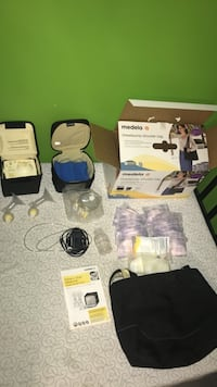white and black Medela electric breast pump set Thurmont, 21788