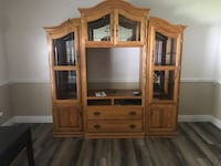 Brown wooden tv hutch... missing glass on right hand door, bottom. Pick up only... Ocoee, 34761