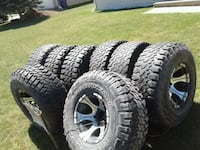 three silver 7-spoke vehicle wheels and tire lot Oneida, 54155