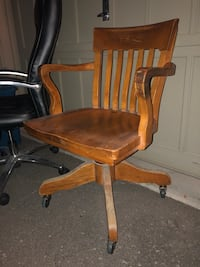 Vintage wooden chair on wheels. One of the inserted wheels needs a bit of glue. Pops out if you pick it up. But all else is fine. Courtice, L1E 0H5