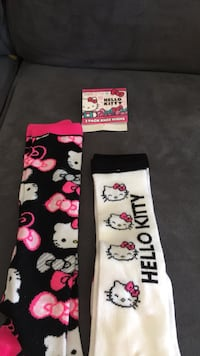 two pairs of black-pink-and-white Hello Kitty knee socks 408 mi