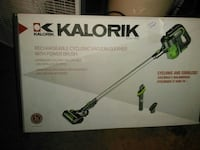 black and green Kalorik rechargeable cyclonic vacuum cleaner with power brush box