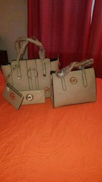 gray leather tote bag and wallet 49 km