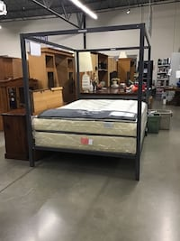 Queen size bed frame and mattress and box spring not included
