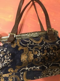 Vintage blue, gold, and grey floral handbag with leather handle