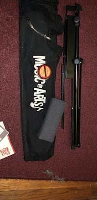 Music stand with violin chin cushion and bow rosin