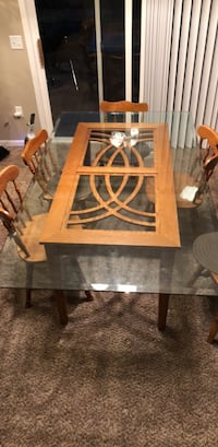 Glass top table with wooden chairs Grand Rapids, 49508