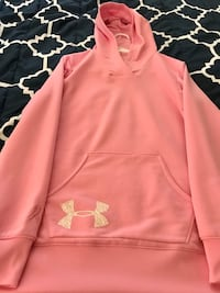 pink and white Under Armour pullover hoodie