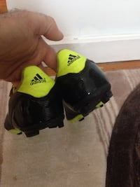 Pair of black-and-green adidas .size 4 Winnipeg, R3X 1T9