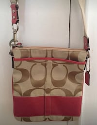 New coach monogrammed pink and brown cross body purse never used