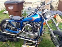 Blue and black cruiser motorcycle 394 mi