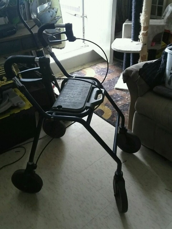 Walker used  folding  and a seat and hand  break s