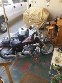 black and red touring motorcycle 2176 mi