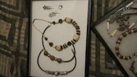 white and black beaded bracelet and earrings  Clearwater