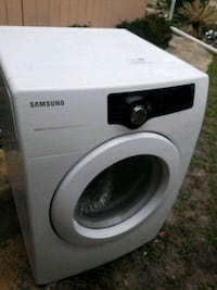 white Samsung front-load clothes washer Brooksville, 34613