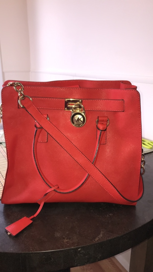 Used Red michael kors leather 2-way handbag for sale in New York - letgo 29debeff69c2d