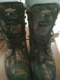 pair of green-and-brown camouflage Survivors combat boots