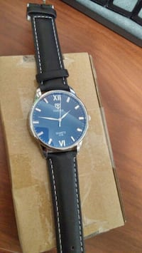 round silver analog watch with black leather strap Hamilton, L8S 2P6