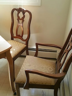 two brown wooden frame brown padded armchairs