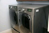 gray front-load washer and dryer set Carlsbad, 92011