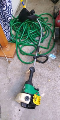 green and black electric string trimmer Sacramento, 95823