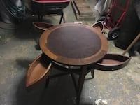 round brown wooden table with drawers