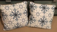 two white-and-blue throw pillows
