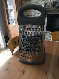 Oversized cheese grater.