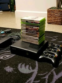 black Xbox 360 console with controller and game cases Washington, 20009