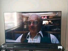 """65"""" smart television +a free cabinet:$400"""