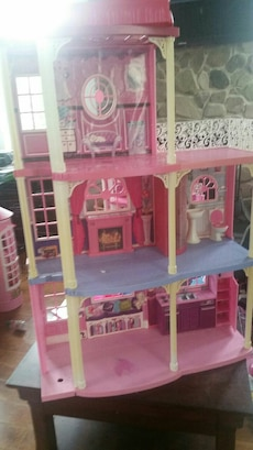 pink and blue 3-story doll house