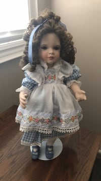 Girl in white and blue dress doll named Gwendolyn with stand and line new. Mississauga, L5B 4G7
