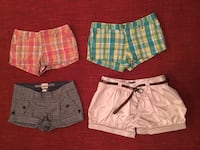 four assorted colors and patterns of shorts