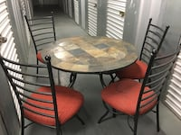 round brown wooden table with four chairs dining set Silver Spring, 20906