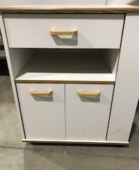 Microwave cart on wheels. With storage. $35 St. Catharines