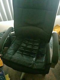 black leather padded rolling armchair 154 mi